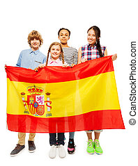 Four multiethnic teenage kids holding Spanish flag - Group...