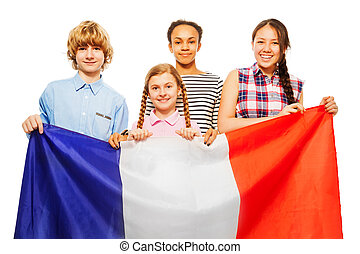 Four happy multiethnic students from France - Four happy...