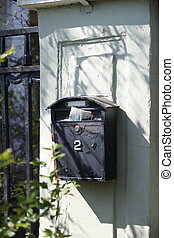 Old mailbox with newspaper