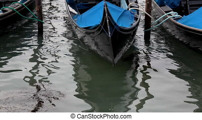 Gondola detail - prow on water with mirror
