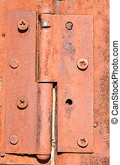 Rusty Orange Door Hinge - Rusty aged door hinge in orange...