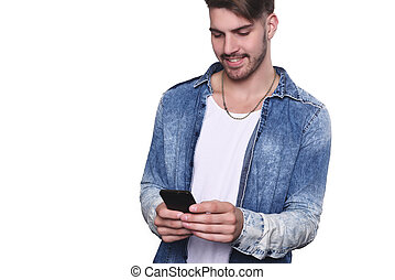 Young man typing on his smartphone.