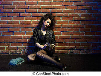 prostitute - portrait of girl dressed like hooker posing...