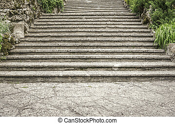 Old stone steps. - Old stone steps in green summer park.