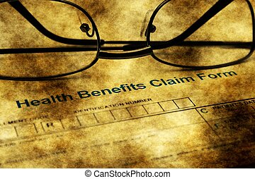 Health benefits claim form grunge concept