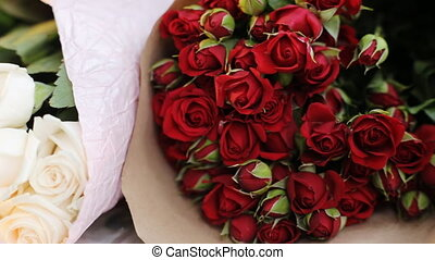 Red and white bouquets of roses.