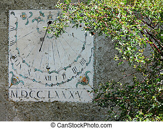 vertical sundial timepiece of ancient times painted on a...