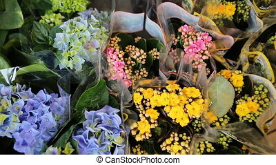 Bouquets of yellow, purple and blue flowers