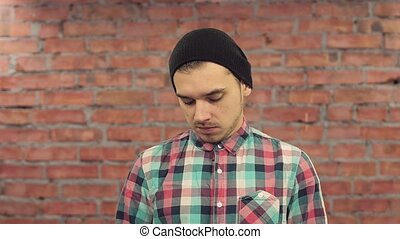 Blogger in black hat, plaid shirt speak words in camera with...