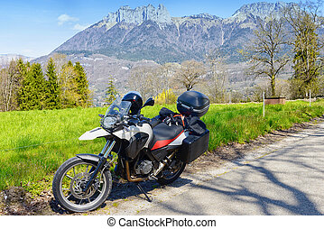 motorcycle with the mountain in the background - a...