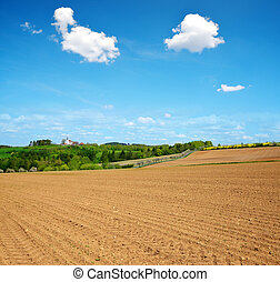 Plowed field in sunny day Spring rural landscape