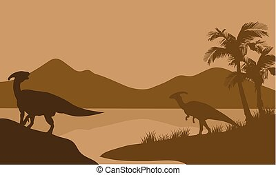 Silhouette of parasaurolophus in lake