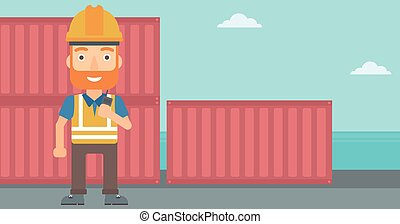 Stevedore standing on cargo containers background. - A...
