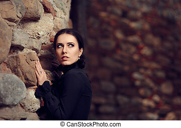 Scared Princess Near Castle Wall - Portrait of gothic queen...
