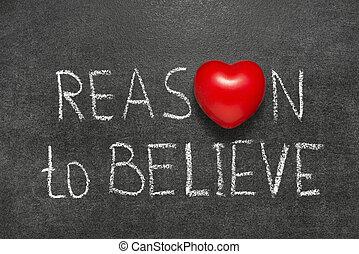 reason to believe phrase handwritten on blackboard with...
