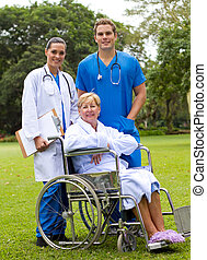 private nurses with patient - private nurse and doctor with...