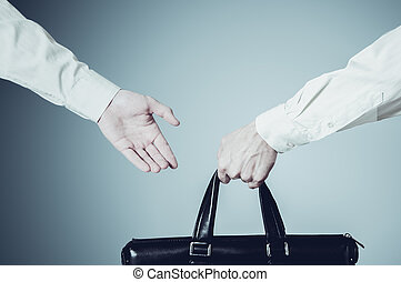 business transfer deal handover of a suitcase for money...
