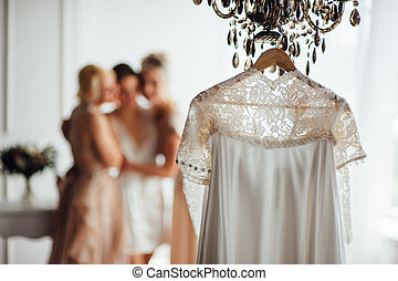 beige lace vintage wedding dress against the background of...