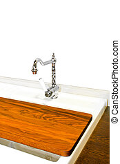 Chopping board - Wooden chopping board on a kitchen sink