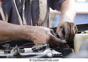 rofessional automotive motor mechanic repair and inspecting the car