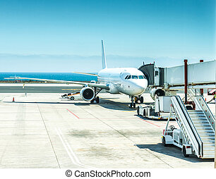 airplane in Lanzarote airport with blue sea and sky on the...