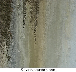 dirty gray wall with dirt rust leak
