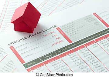 Mortgage loan balance sheet with a miniature red paper house