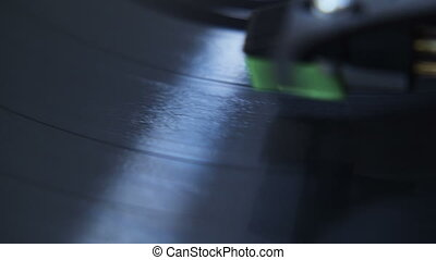 Macro Groovy Record Tracks - Macro close up above a stylus...
