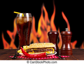 Cola, hamburger, french fries and spices on background...