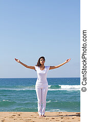 indian spiritual woman in white clothing on the beach