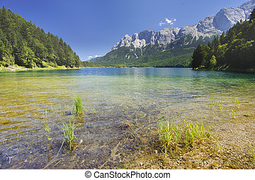 lake and alps mountains in Bavaria - lake Eibsee nearby city...