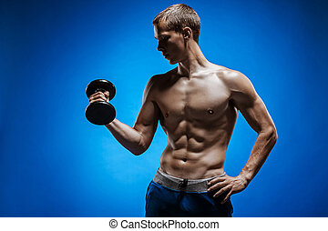 Fit young man with beautiful torso on blue background - The...