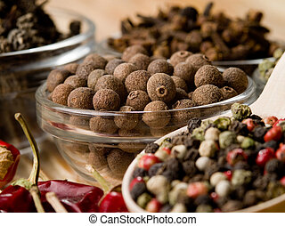 allspice in a spoon on a table