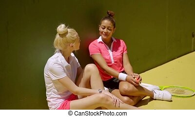 Two athletic young women tennis players - Two attractive...