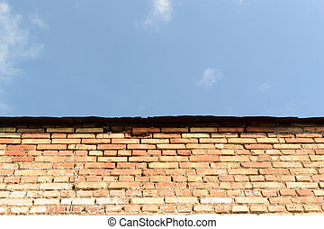 Old Brick Wall and Blue Sky