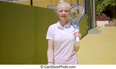Relaxed attractive young woman tennis player - Relaxed...