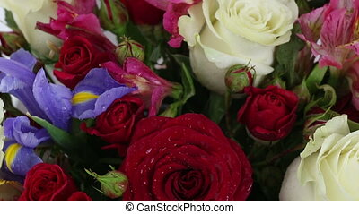Beautiful bouquet roses, iris and alstroemeria rotates -...