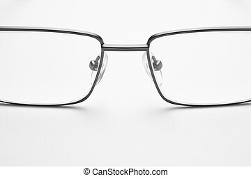 Male eyeglasses detail over a white background. Horizontal