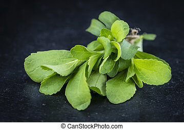 Stevia leaves - Portion of Stevia leaves (selective focus;...