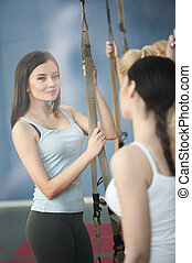 Cheerful women are resting in gym - Beautiful young girls...