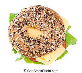 Bagel with Cheese Gouda and some fresh vegetables close-up...