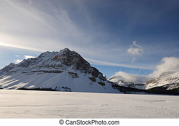 winter canadian rockies - snow capped mountain in winter at...
