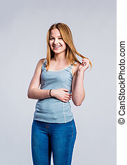 Girl in jeans and singlet, young woman, studio shot -...