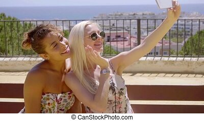 Two young women posing for a selfie outdoors - Two stylish...