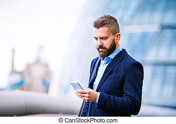 Hipster manager with smart phone, London City Hall - Hipster...