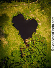 Beautiful heart-shaped lake Natural heart-shaped lake in the...