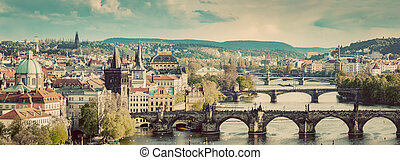 Prague, Czech Republic bridges skyline with historic Charles Bridge and Vltava river. Vintage