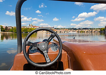 Admiring Prague from paddle boat on Vltava river in Prague,...