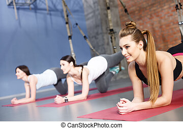 Cute women doing push-ups with resistance band - Pretty fit...