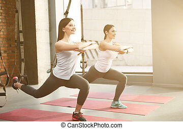 Attractive sporty women are doing exercise - Beautiful young...